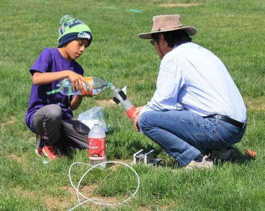 UW space scientist Robert Winglee and a student prepare to launch a bottle rocket. As part of the new effort, more teachers will be trained to do rocketry demonstrations.