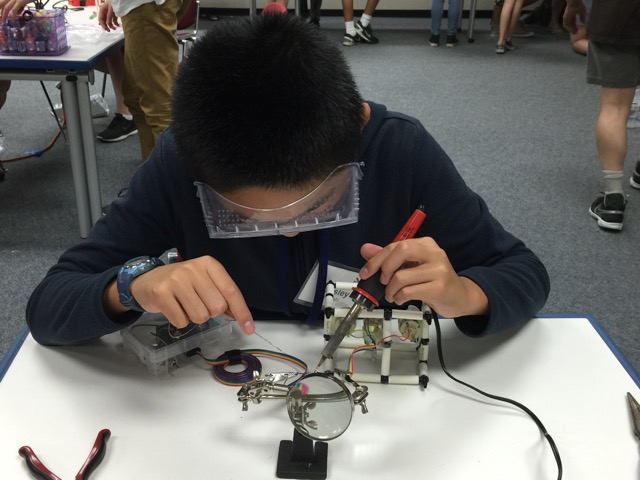 Alexander Riley works on the ROV during summer camp.