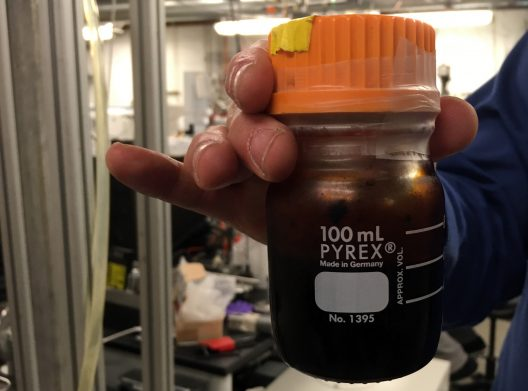 A container of bio oil, produced by the UW research team.