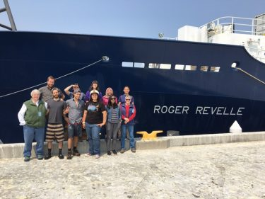 Deborah Kelley (left) and undergraduate students in Newport, Oregon, on Aug. 9 at the end of the first leg of the cruise.