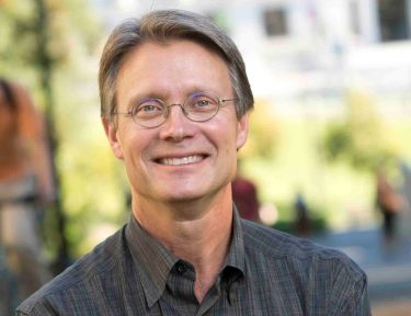 A photo of professor Mark Richards, a middle-aged white man with blue eyes and sandy hair who wears glasses.