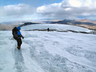 The Gobi-Altai mountain range in western Mongolia is in a very dry region but ice can accumulate on mountaintops, such as Sutai Mountain, the tallest peak in the range. In the picture, friends of Jigjidsurengiin Batbaatar descend this mountain after helping to install a weather station.
