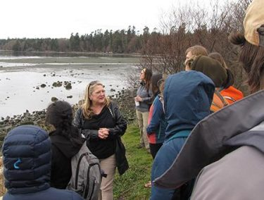 Friday Harbor Labs director Billie Swalla speaks with class at San Juan Island's False Bay.