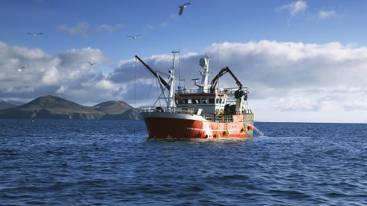 Fishing boat on open waters near Dingle Peninsula coast.