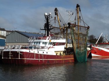 A vessel known as a beam trawler sits at the dock in Milford Haven, Wales, United Kingdom.