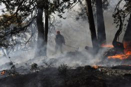 A tribal fire crew member in Oregon monitors a prescribed burn, a key tool for preventing large wildfires that are likely to become more common under climate change.