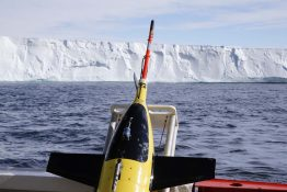 A Seaglider, with the Getz Ice Shelf in the background, being prepared for deployment in January 2018 under the neighboring Dotson Ice Shelf.