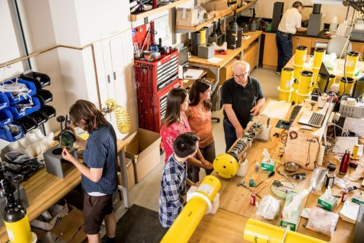 Steve Riser (center, in black), students and technicians in July 2017 inside the UW School of Oceanography's floats lab.