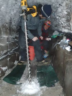 Zac Cooper and Shelly Carpenter begin to drill below the Alaskan ice tunnel toward the cryopeg and its salty subzero water. Researchers are careful to sterilize their equipment to avoid introducing contamination from above ground. The most stringent of such techniques will be needed to sample for life on other planets. Go Iwahana/University of Alaska, Fairbanks