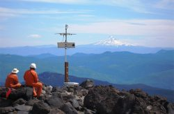 Field engineers Karl Hagel and Pat McChesney with Mount Hood in the distance.