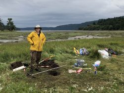 Carrie Garrison-Laney, tsunami hazard specialist with Washington Sea Grant, collecting sediment data in Discovery Bay.